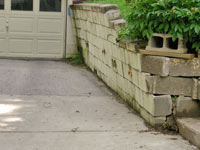 a failing retaining wall around a driveway in Lexington