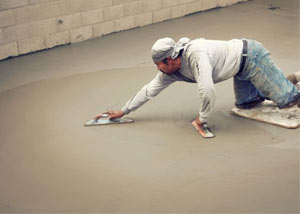smoothing out the grout in a slab releveling project in Florence