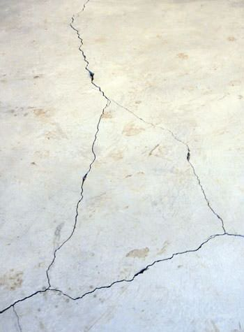 severely cracked, heaving slab floors in a home in La Grange
