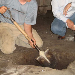 Digging a hole for the engineered fill used in a crawl space support system installation in Taylorsville
