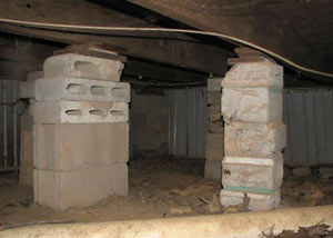 crawl space repairs done with concrete cinder blocks and wood shims in a Fort Thomas home