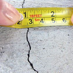 A crack in a poured concrete wall that's showing a normal crack during curing in Somerset