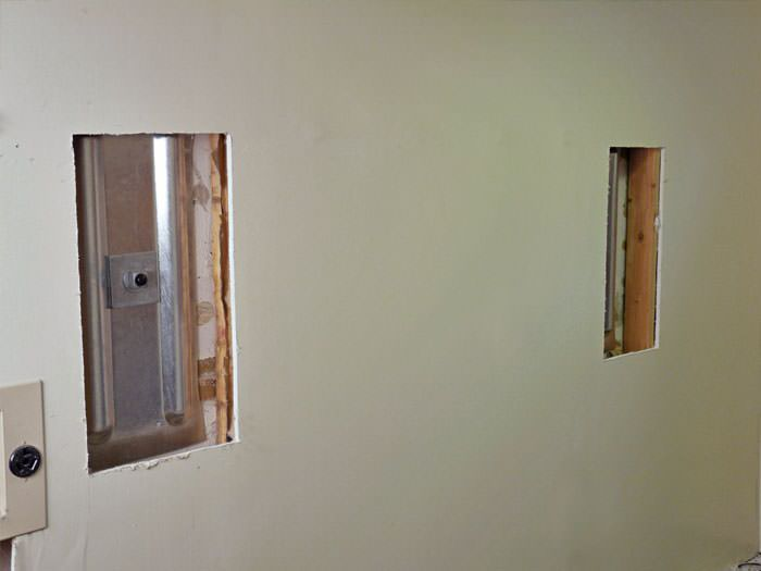 ... Wall anchor plates installed during a foundation repair in Lexington in  a finished basement ...