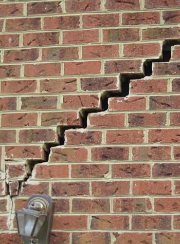 major cracking of a brick foundation wall in Middlesboro