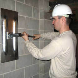 installing a wall anchor to repair an bowing foundation wall in Frankfort