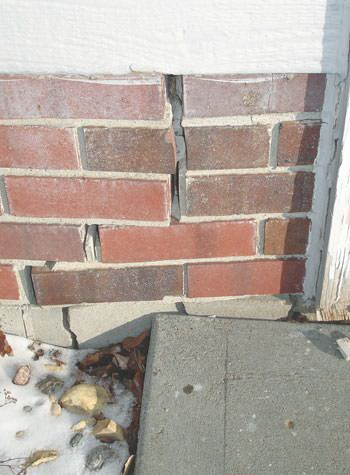 Severe street creep damage to a garage wall outside a Shepherdsville home