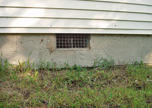 Open crawl space vents that let rodents, termites, and other pests in a home in Burlington