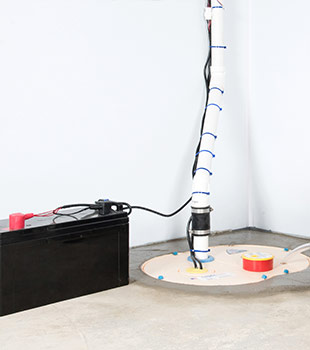 A sump pump installed in Vine Grove by The Basement Doctor of Central Kentucky