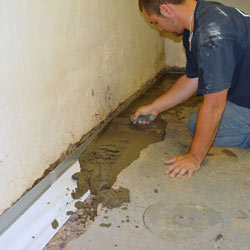 Testing a French drain system in a Lawrenceburg home.