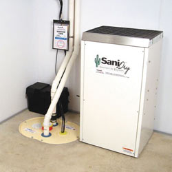 Sump pump system, dehumidifier, and basement wall panels installed during a sump pump installation in Brandenburg
