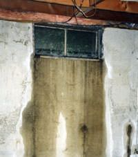 Flooding through basement windows in a Somerset home.