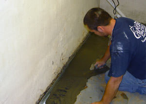 Restoring a concrete slab floor with fresh concrete after jackhammering it and installing a drain system in Bardstown.