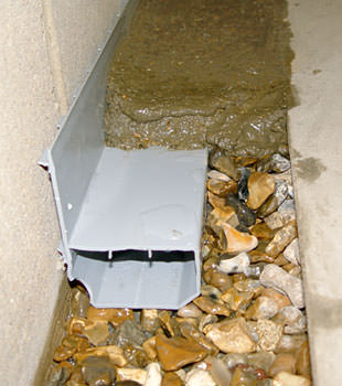 A basement drain system installed in a Florence home