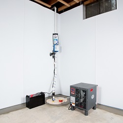 Sump pump system, dehumidifier, and basement wall panels installed during a sump pump installation in Erlanger