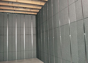 SilverGlo™ insulation and metal studs making up our Basement to Beautiful panels.  Installed in Richmond.